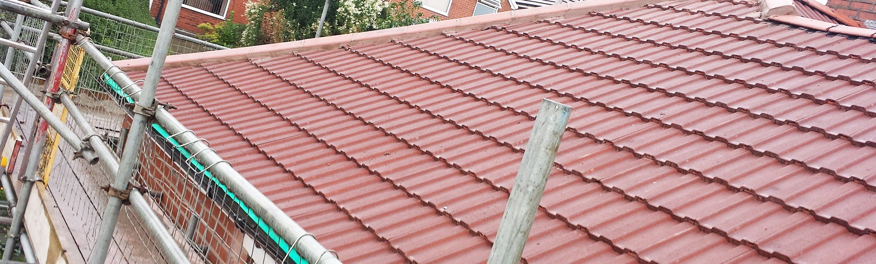 Roofer constructing a tiled roof